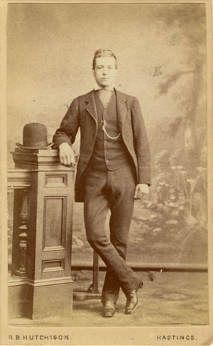 ABOVE A Carte De Visite Portrait Of Young Man Standing In Front Painted Backdrop Photographed By Robert Bell Hutchison 52 Robertson Street
